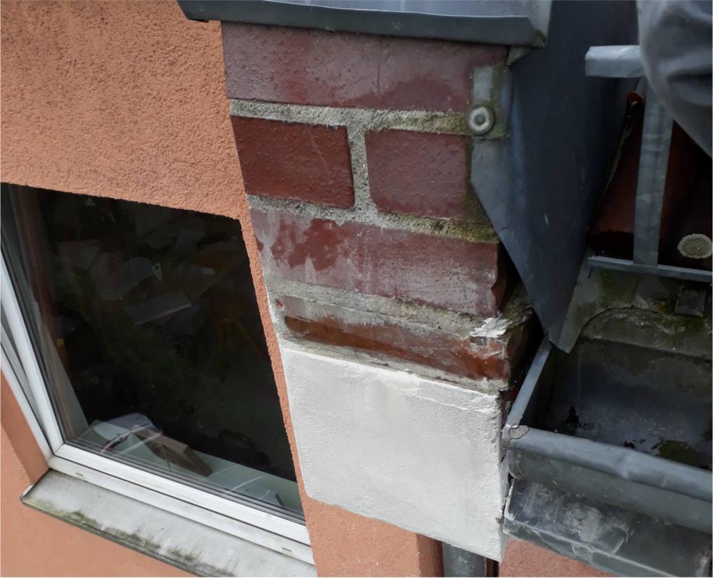 Reparatur einer Brandwand im Traufbereich